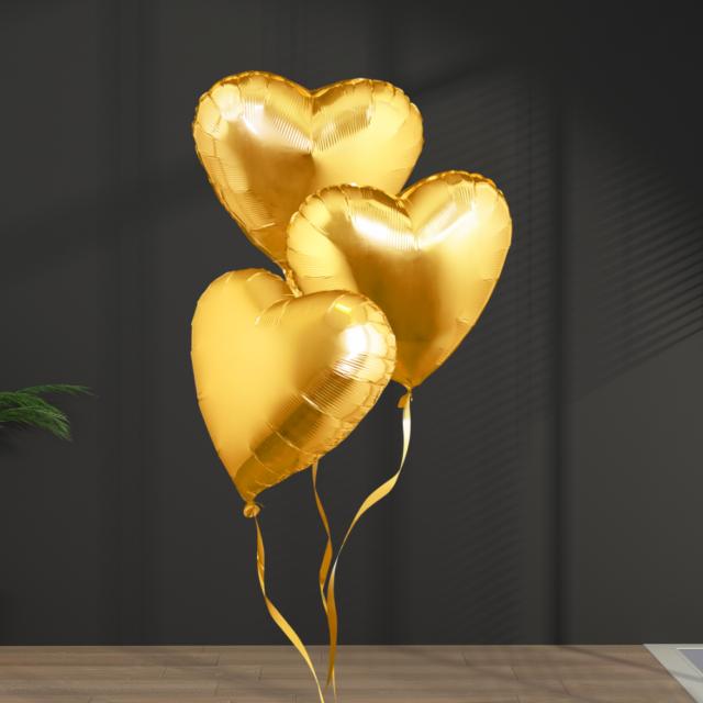 heart balloons in golden for anniversary